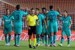 Lionel Messi (R) celebrates with his Barcelona teammates after scoring the final goal in their 4-0 win at Mallorca on Saturday