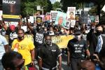 Protestors gather for a march organized by the National Association for the Advancement of Colored People (NAACP) in Atlanta, Georgia, to protest the fatal shooting of a black man by a white police officer