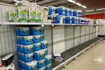 Near-empty shelves of toilet paper in a Melbourne supermarket