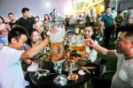 Beer-lovers were reassured by China's low numbers of new virus cases, and turned out to raise a glass