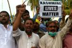 Protesters in Karachi shout slogans during a rally to show solidarity with people of Indian-administered Kashmir on August 5