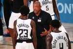 """Los Angeles Clippers coach Doc Rivers (C, pictured August 25, 2020) blasted systemic racism and police brutality in the US, saying, """"It's amazing to me why we keep loving this country and this country does not love us back"""""""