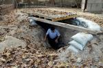 A man emerges from a makeshift bomb shelter in the village of Sahlabad outside the Azerbaijani city of Tartar