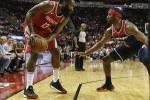 James Harden #13 of the Houston Rockets controls the ball defended by John Wall #2 of the Washington Wizards
