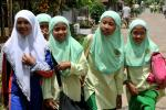 """Indonesia says public schools can no longer force girls to wear the """"hijab"""" headscarf"""