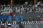 Japan's virus measures are limited, with bars and restaurants requested but not obliged to close by 8pm and working from home strongly recommended
