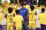 Anthony Davis #3 of the Los Angeles Lakers talks with teammates Wesley Matthews #9 and Kentavious Caldwell-Pope #1