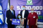 Veteran incumbent Benjamin Netanyahu has sought to take credit for Israel's coronavirus vaccination effort which is the envy of many nations -- here he is seen posing earlier this month with the five millionth citizen to receive a first shot
