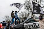 Protesters clashed with police in Minneapolis after an officer shot and killed a Black man during a traffic stop