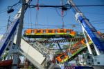 Rescue workers use cranes to remove the wreckage of a metro train that fell as an overpass collapsed in Mexico City