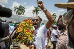 Demonstrators pray and demand justice outside of the Presidential Palace in Port-au-Prince on July 14, 2021, in the wake of Haitian President Jovenel Moise's assassination on July 7, 2021.