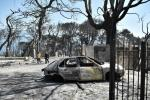 A car destroyed by flames east of Patrasin the Peloponnese as Greece battles fires during a punishing heatwave
