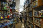 An employee walks in the aisles of Mary Arnold Toys in New York on August 2, 2021; co-owner Judy Ishayik is urging customers to shop for Christmas as early as September due to Covid-linked supply snags