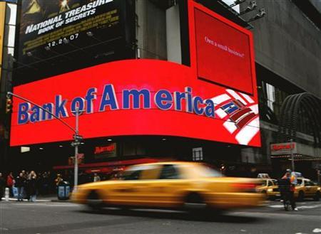 A taxi speeds past a Bank of America branch in New York's Times Square