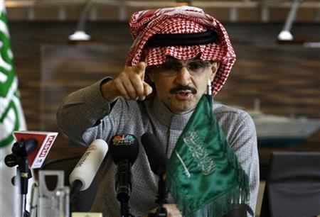 Saudi billionaire Prince Alwaleed bin Talal reacts during a news conference in Riyadh