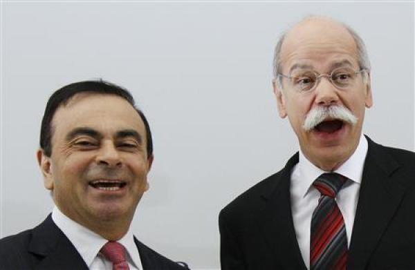Dieter Zetsche (R), chief executive officer of German car manufacturer Daimler AG, shakes hands with Carlos Ghosn (L), chief executive officer of Renault-Nissan Alliance, before signing an agreement in Brussels, April 7, 2010.