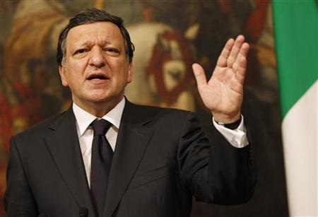 European Commission President Jose Manuel Barroso gestures during a joint news conference with Italy's Prime Minister Silvio Berlusconi at the end of a meeting at Chigi Palace in Rome