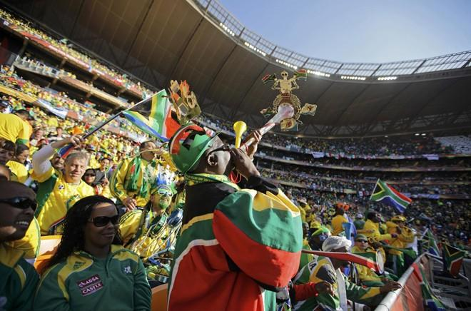 South African fans blow vuvuzelas before the opening match between Mexico and South Africa.