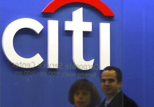 Employees walk through the Citigroup headquarters in New York