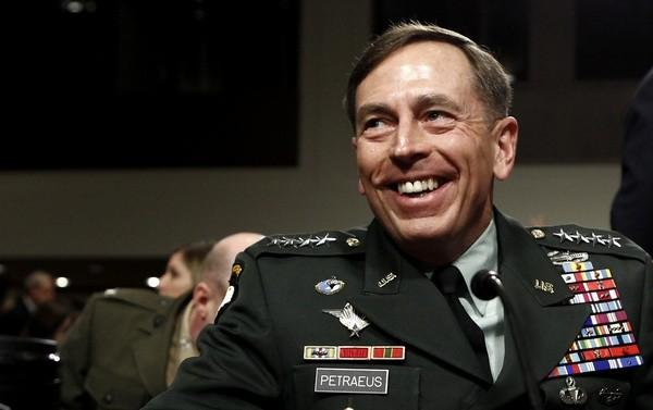 U.S. General David Petraeus smiles as he prepares to testify at his Senate Armed Services Committee confirmation hearing to become commander of U.S. forces in Afghanistan on Capitol Hill in Washington June 29, 2010