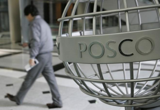 An employee of steelmaker POSCO walks at the company's headquarters in Seoul