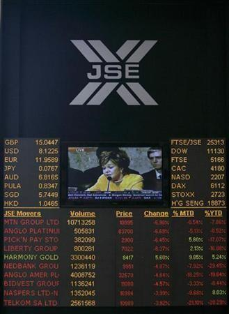 An electronic board displaying movements in major indices is seen at Johannesburg stock exchange in Sandton
