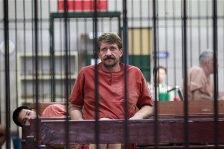 Suspected Russian arms dealer Viktor Bout sits in a holding cell after arriving at a Bangkok criminal court