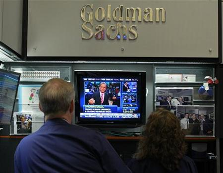 Traders work in the Goldman Sachs stall on the floor of the New York Stock Exchange