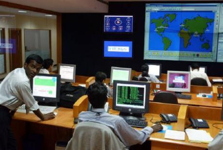 Engineers work in the control room at Infosys Technologies campus in Bangalore
