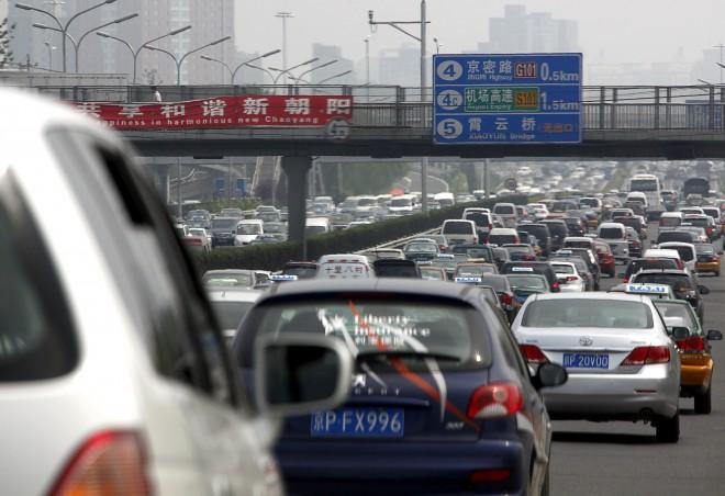 Cars can be seen in a traffic jam along a main road in central Beijing