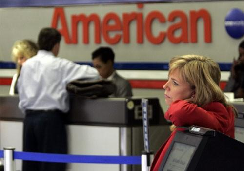 An American Airlines passenger service representative stands at Dallas/Fort Worth International Airport