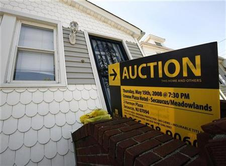 A foreclosed home up for auction is seen during the Long Island Foreclosure Tour in New Hyde Park, New York