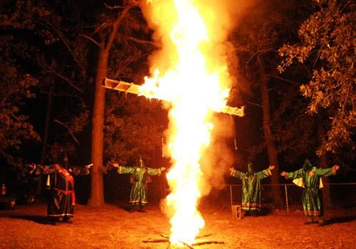 Members of the Ku Klux Klan (KKK) participate in a cross-lighting ceremony at a Klansman's home in Warrenville, S.C., Oct. 23, 2010.