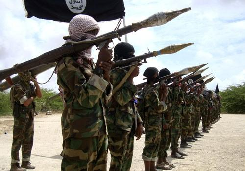 Al Shabaab militants parade new recruits after arriving in Mogadishu October 21, 2010, from their training camp south of the capital of Somalia