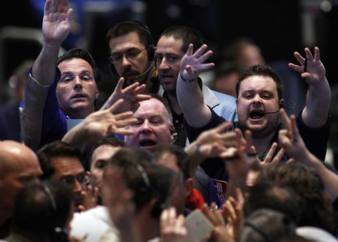 Traders signal orders in a bond options pit at the CBOT in Chcago