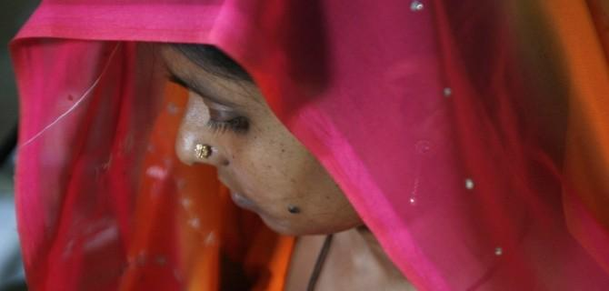 A woman suffering from HIV/AIDS waits to receive vaccine 'Pneumovax' during a vaccination programme organised by non-government organisation 'Sngobadho' (Together) at their office on the outskirts of the northeastern Indian city of Siliguri August 5, 2008
