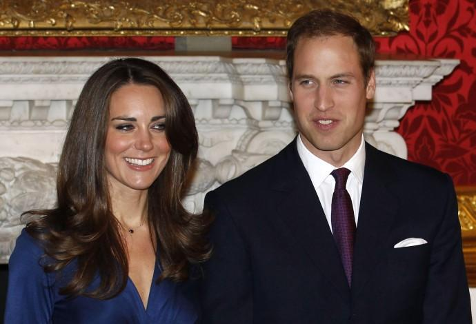 Britain's Prince William and his fiancee Kate Middleton