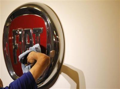 A worker polishes a Fiat logo during the launch of Chrysler-s flagship showroom in Los Angeles November 16, 2010.