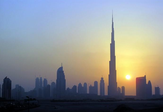 The Burj Khalifa is seen as the sun sets over Dubai