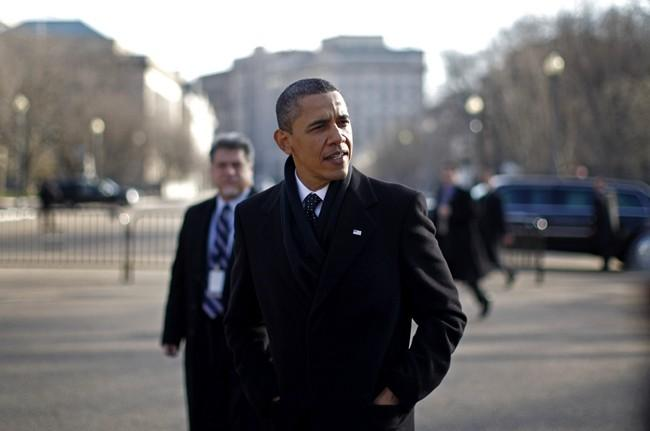 U.S. President Barack Obama walks out of the White House to cross Pennsylvania Avenue to meet with business leaders at Blair House in Washington, December 15, 2010.