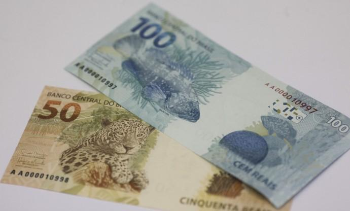 A photo illustration of new Brazilian R$50 and R$100 real currency notes after their launch in Brasilia