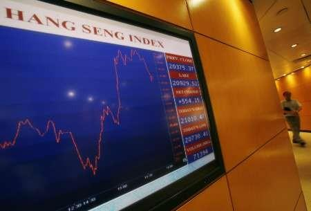 A panel displays the daily blue-chip Hang Seng Index movement at the Hong Kong Exchange