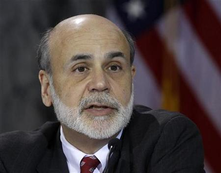 Chairman of the Federal Reserve Ben Bernanke speaks during a meeting in Washington