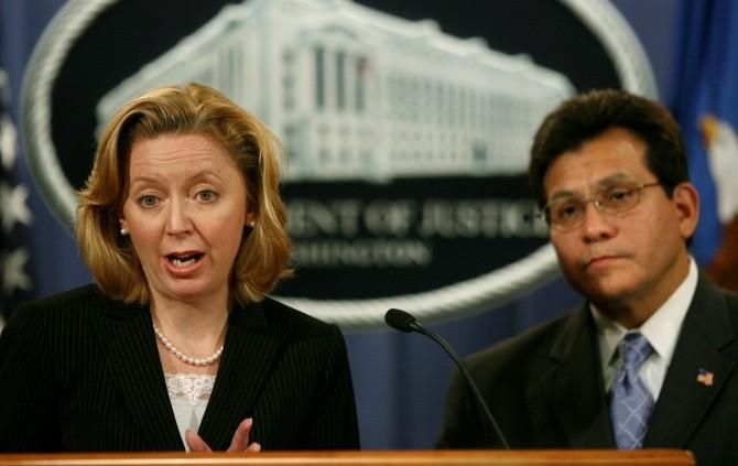 U.S. Federal Trade Commission Chairman Deborah Platt Majoras speaks to the press alongside U.S. Attorney General Alberto Gonzales following a meeting of the Identity Theft Task Force at the Justice Department in Washington, September 19, 2006.
