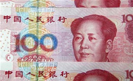 Chinese 100 yuan banknotes are seen in this picture illustration taken in Shanghai