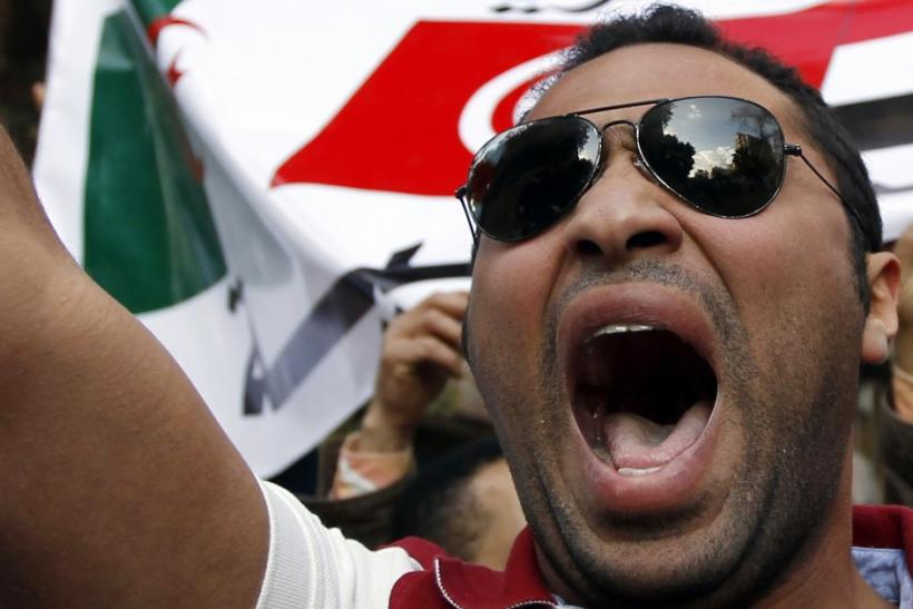 A Libyan protester shouts slogans against Libyan leader Muammar Gaddafi during a demonstration outside the Libyan Embassy in Cairo