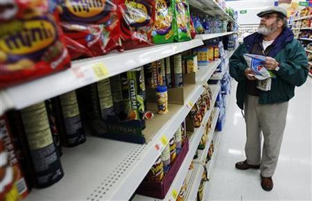 Michael Lipsitz picks out a bag of chips while grocery shopping at the WalMart in Crossville