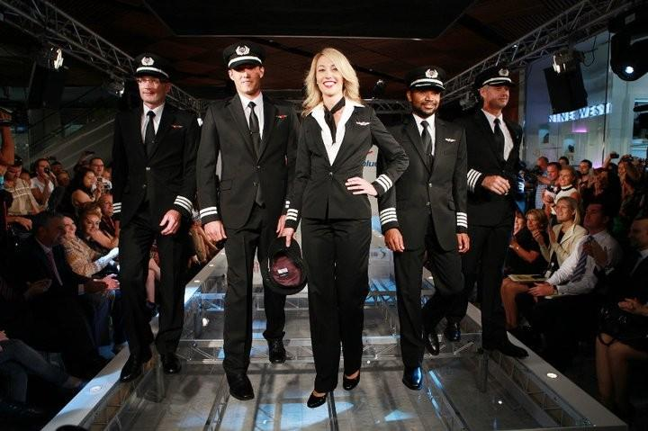 Elle Macpherson launches Virgin Blue's new designer uniforms.