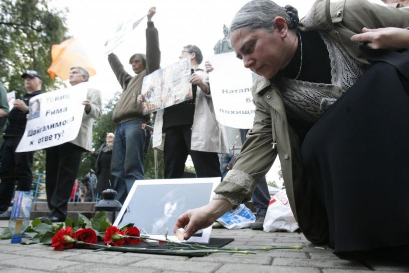 Russian rights group Memorial and its founder Svetlana Gannushkina [Photo: A woman places a candle near a portrait of slain Russian human rights activist Natalya Estemirova in Moscow, August 24, 2009. Estemirova, a human rights activist for the group Memo