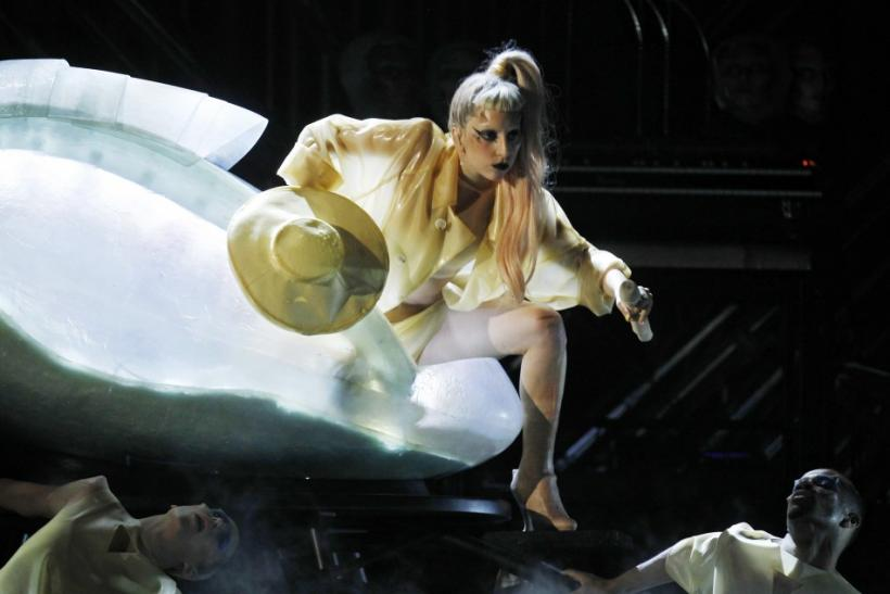 "Lady Gaga steps out of a translucent egg to perform her new song ""Born This Way"" at the 53rd annual Grammy Awards"
